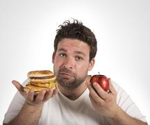 Diet vs junk food Stock Photos