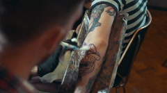 Stock Video Footage of Tattoo artist make tattoo, close up