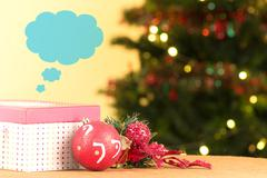 Purple Christmas gift box with ornaments and tree, think cloud Stock Photos