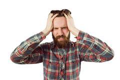 Handsome hipster getting a headache Stock Photos