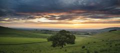 Stock Photo of Beautiful Summer sunset landscape Steyning Bowl on South Downs