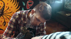 Stock Video Footage of Tattoo artist make tattoo at the studio