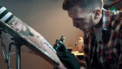 Tattoo artist make tattoo, dolly shot - stock footage