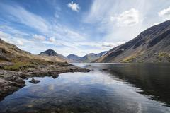 Stunning landscape of Wast Water and Lake District Peaks on Summer day reflec Stock Photos