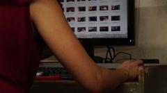 Lady desktop operator scrolling files Stock Footage