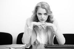 Serious business woman underlaying Stock Photos