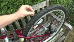 Bike puncture – tack in tyre/tire. - stock footage