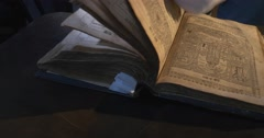 Man in White Gloves is Leafing Through The Old Book, Pages with Pictures Stock Footage