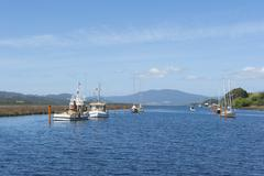 Anchoring boats on the water of Huon River valley south of Hobart, Tasmania, - stock photo