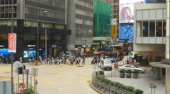 Large crowds and busy street next to HK billboard 4K Stock Footage