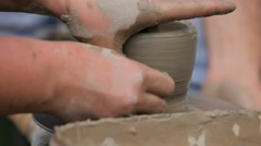 Women's hands making ceramic cup on potter's wheel Stock Footage