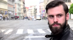 Young handsome hipster man looks around - city - urban street - closeup face Stock Footage