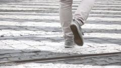 Young man go across the road - pedestrian crossing - closeup legs Stock Footage