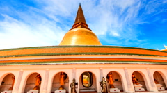 Golden pagoda and blue sky, Nakhonpathom Province, Thailand. Stock Footage