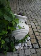 old-style greek amphora laying on earth - stock photo