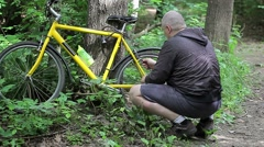 Man repairing bicycle Stock Footage