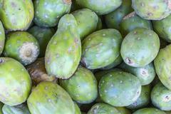 Fruits of Opuntia ficus-indica, cactus fruit (tuna) on a market in Peru. - stock photo