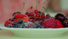 Fresh berry fruits being sprinkled by sugar Stock Footage