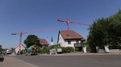 Working construction site in small quiet village Stock Footage
