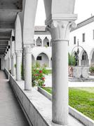 rectangular cloister with Gothic arches and  columns. - stock photo