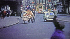 COLOGNE, GERMANY - 1966: A poor man biking a large quantity of unknown goods - stock footage
