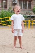 The three-year girl crying on the playground Stock Photos