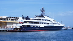 MEGA YACHT LUXURY SHIP ATTESSA IV stern with luxury boat side view Stock Footage