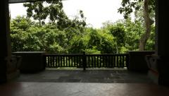Shaded terrace under roof against tropical forest in sunshine Stock Footage