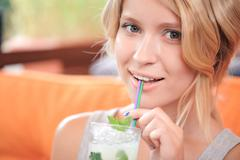 Close-up of blond woman drinking cocktail Stock Photos