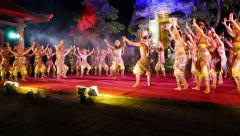 Modern Balinese dance performance at night stage, large troupe steps in rhythm Stock Footage