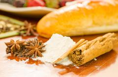 Anise star and flour on a kitchen - stock photo