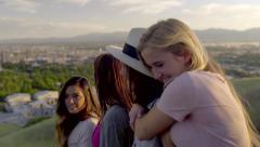 Teens Watch The Sunset From Scenic Overlook, Girl Hugs Her Friend (Slow Motion) Arkistovideo