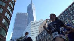 Runners in race with Freedom Tower, One World Trade Center in Background Stock Footage