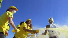 Adventure runners sprayed with color yellow Stock Footage