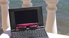 The laptop and sunglasses Stock Footage