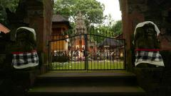 Closed split gate at Pura Dalem, move close and look through Stock Footage