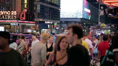 Crowded street, New Yorkers and tourists walking 42nd Street night Manhattan NYC Stock Footage