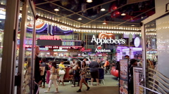 Applebee's BB Kings with tourists walking doors from inside nightclub NYC Stock Footage