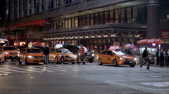 taxis and cars on 8th Ave traffic at night in Manhattan at 42nd Street, NYC - stock footage