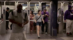 people entering subway station through turnstiles 42nd st station Times Square - stock footage