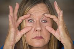 Tired stressed woman migraine headache - stock photo