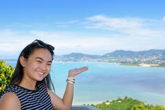 Women tourist inviting to see of the sea in Phuket Province, Thailand Stock Photos