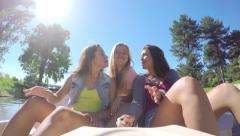 Girls Ride A Pedal Boat, They Kiss Their Friend On The Cheek At The Same Time Stock Footage