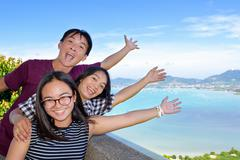 Family of tourists inviting to see the sea in Phuket, Thailand Stock Photos