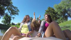 Friends Ride In Pedal Boat, Girl Pretends To Pedal Too With Her Legs In The Air - stock footage