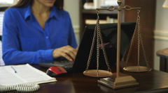 Stock Video Footage of woman attorney working focus on scales of justice