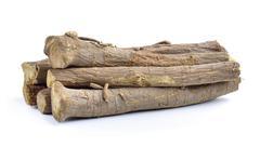 Liquorice roots isolated on white background - stock photo