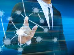 Businessman pushing a touch screen interface Stock Illustration