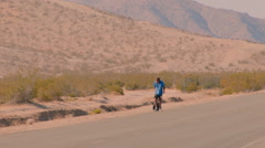 HOMELESS MAN WANDERS IN THE DESERT Stock Footage