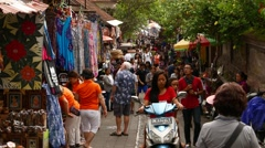 Crowded market street in Ubud, overhead perspective shot, people walking Stock Footage